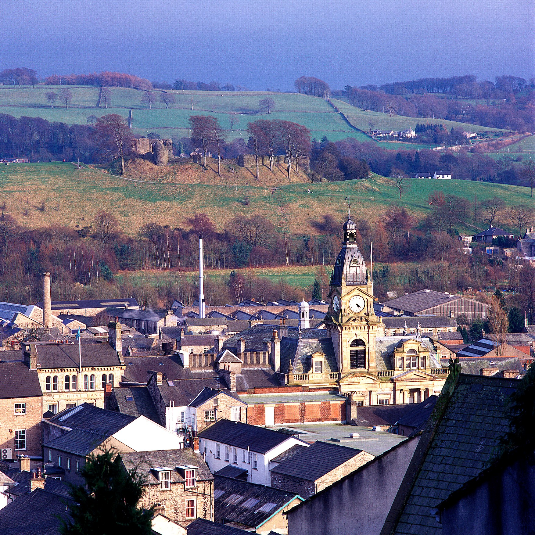 A view across the roof tops of kendal with the castle in the background © www.golakes.co.uk