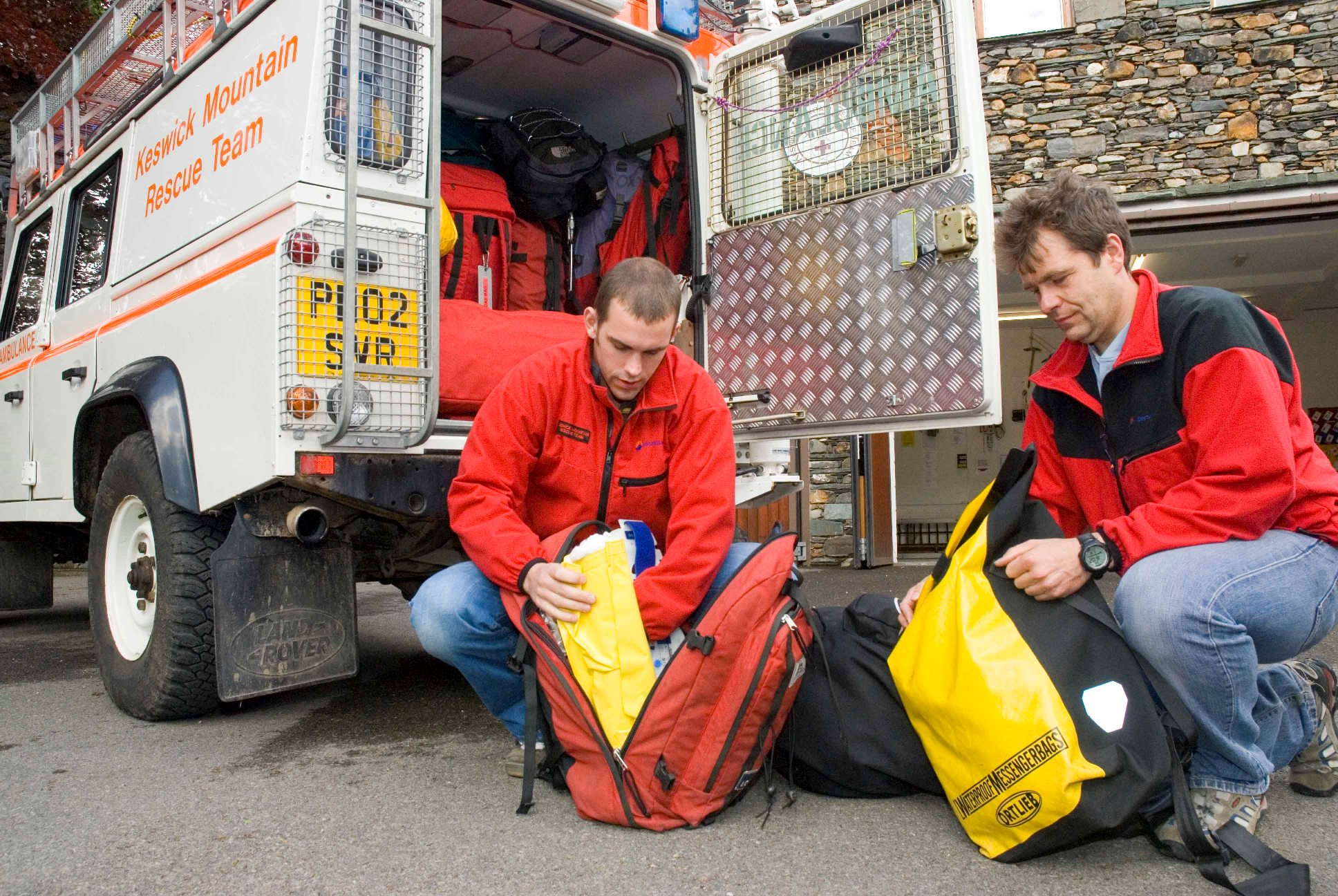 Keswick Mountain Rescue Team members preparing their kit.