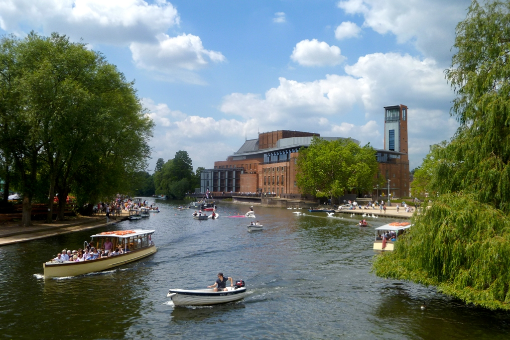 Stratford River Festival showing small boats on river Avon and RSC in background