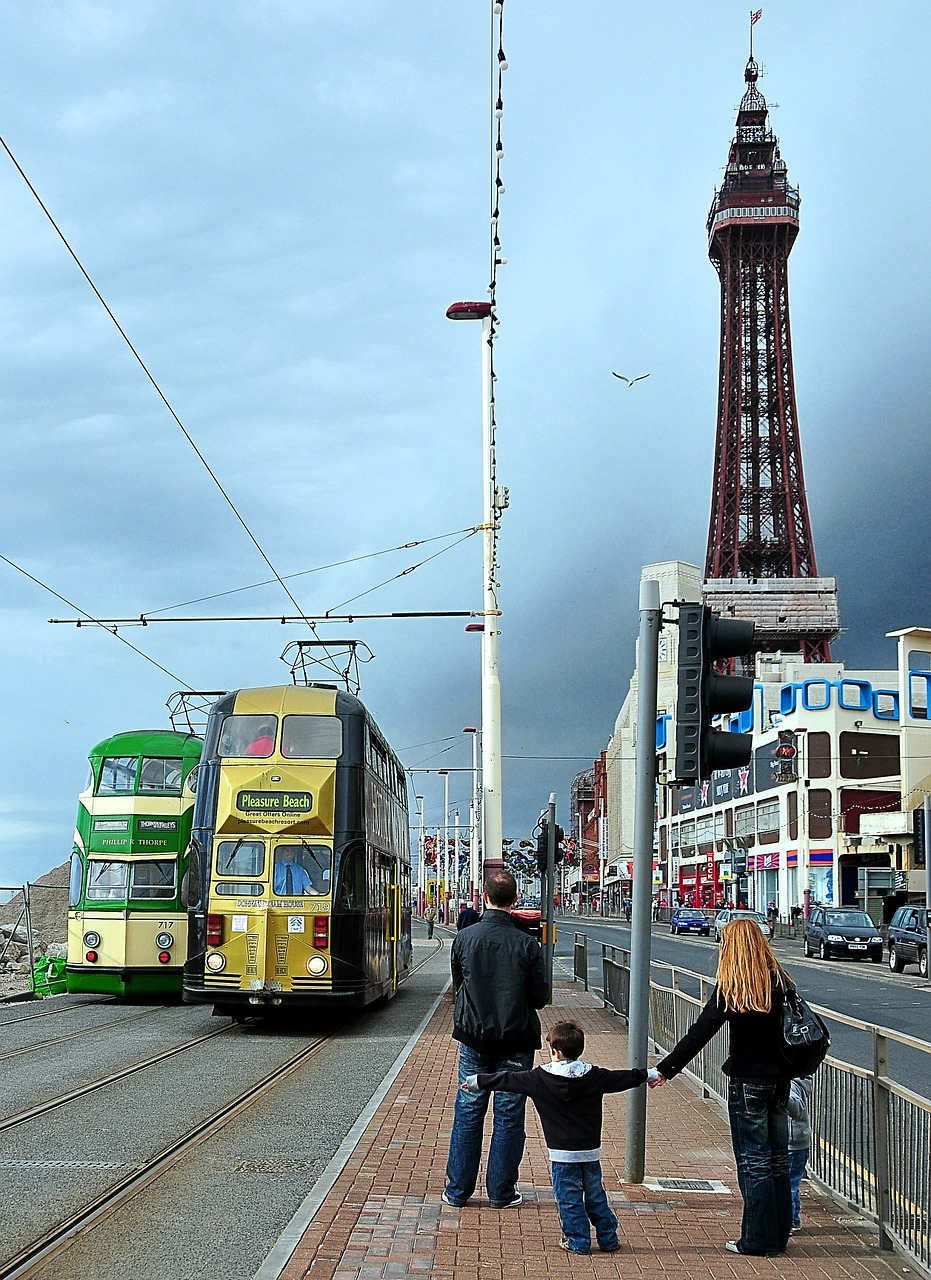 Child holding out his arm to catch a tram in Blackpool by digihanger on Pixabay
