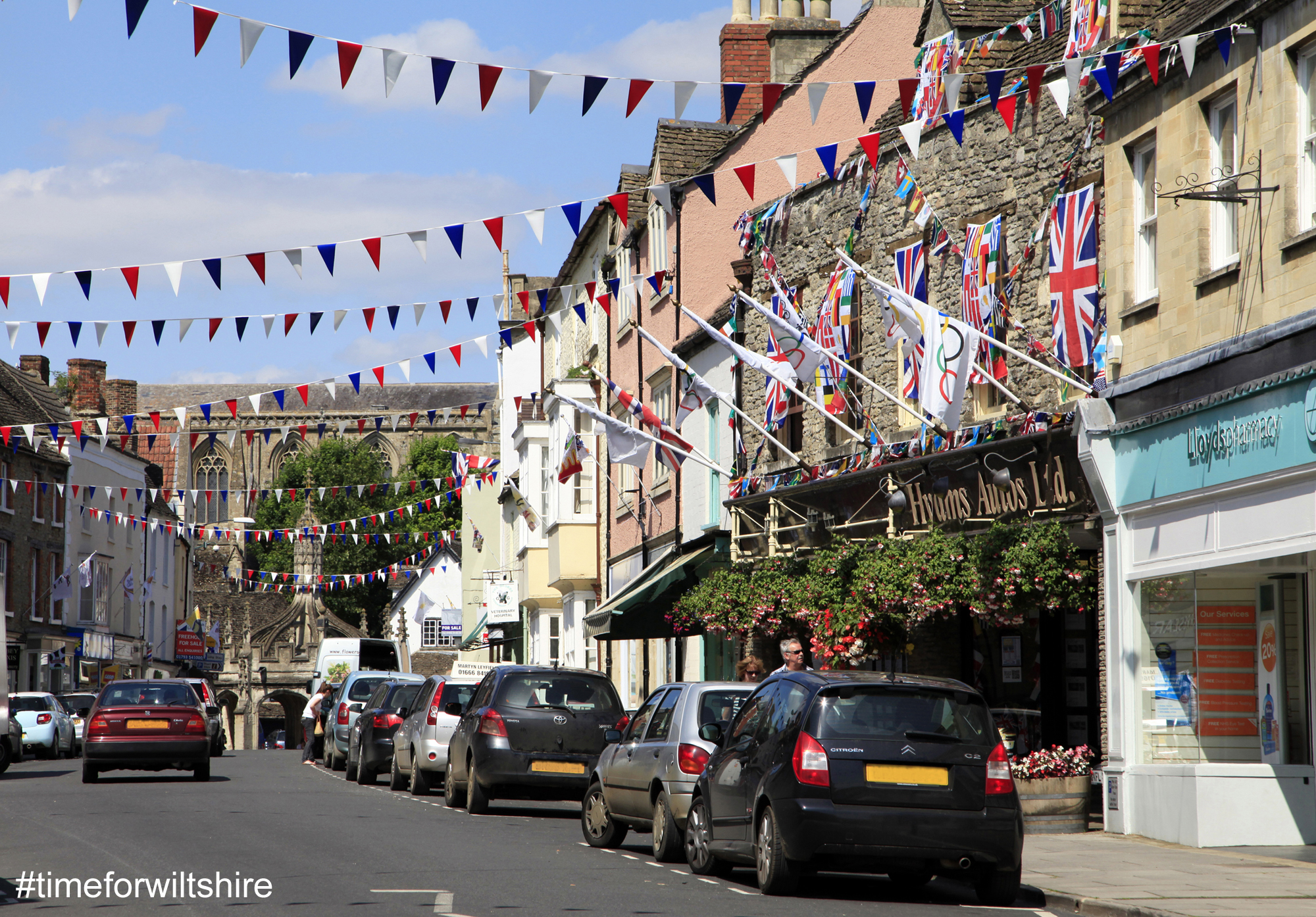 Shopping street with bunting flying Malmesbury © www.visitwiltshire.co.uk