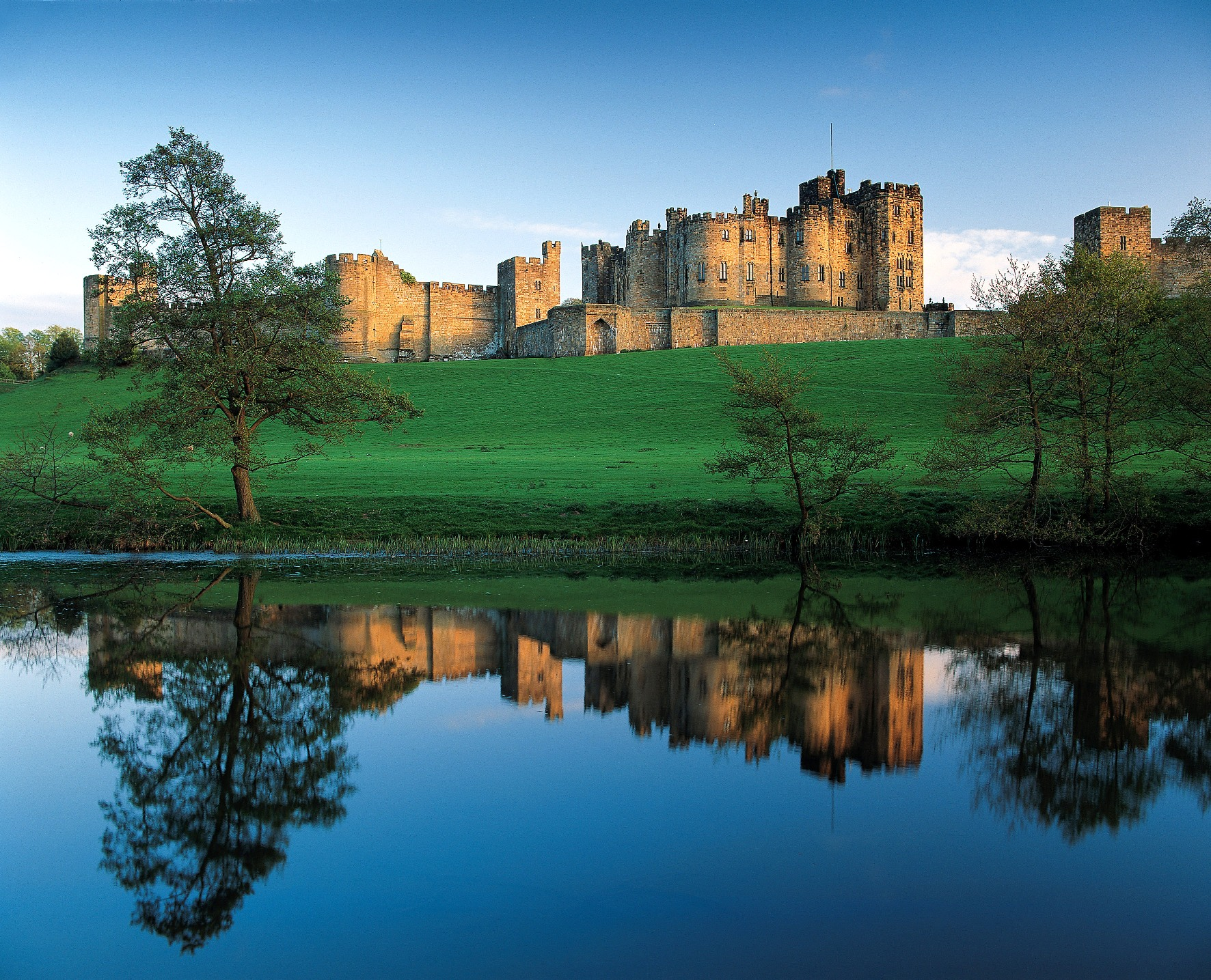 Castle reflected in the River Aln