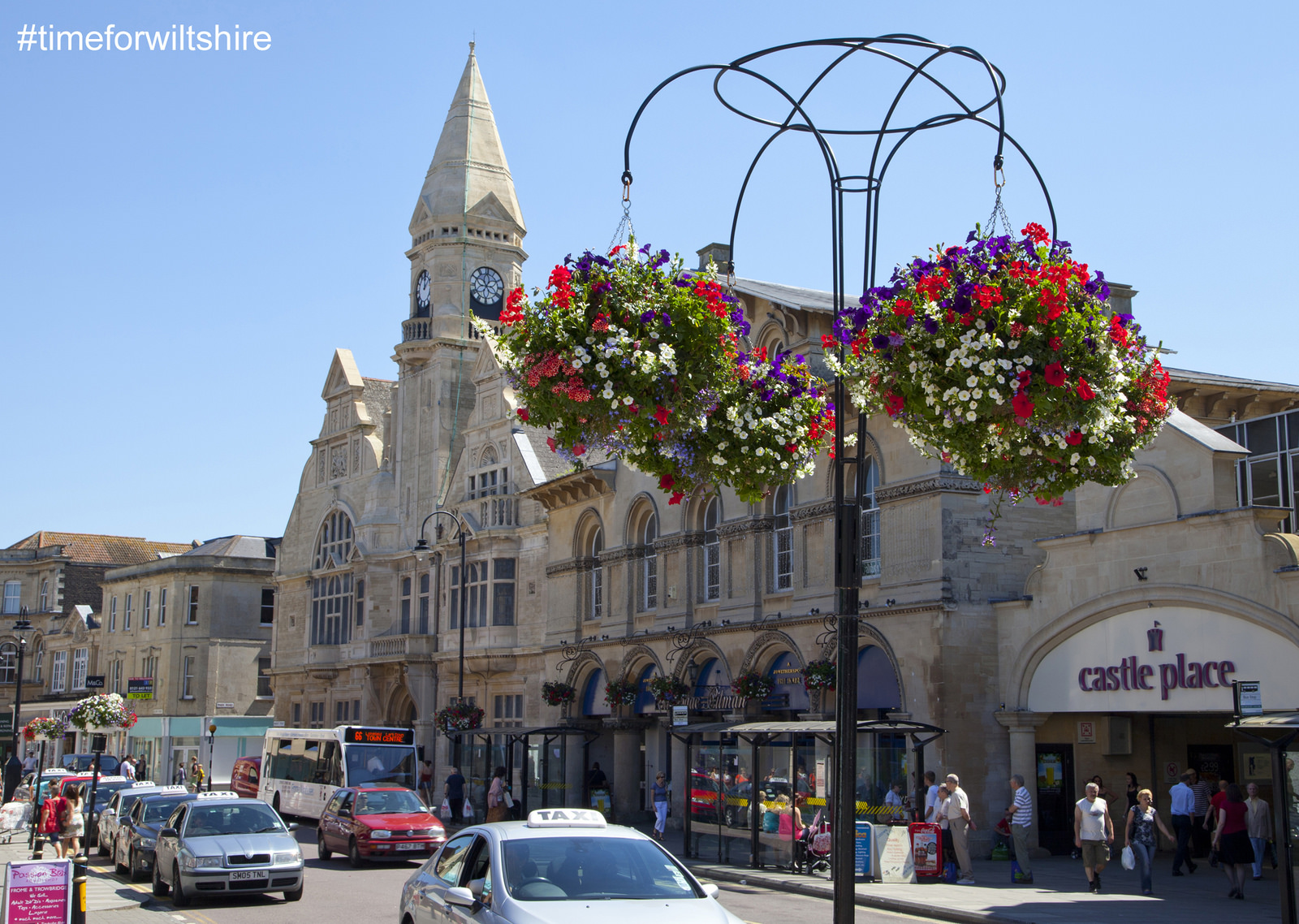 Trowbridge Town Hall shows summer flower displays and hanging baskets © Visit Wiltshire