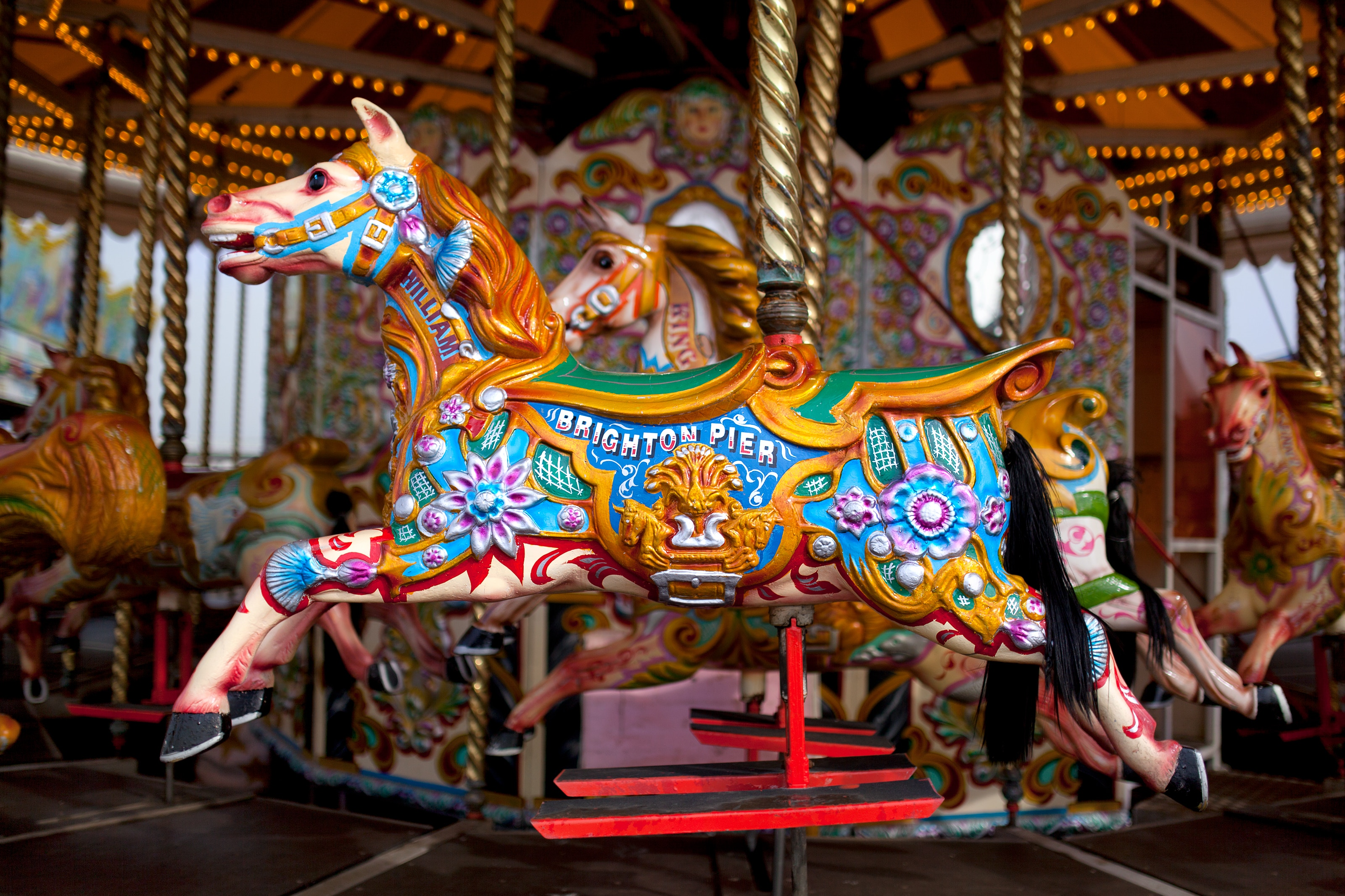 A merry-go-roung horse by Miles Storey on unsplash
