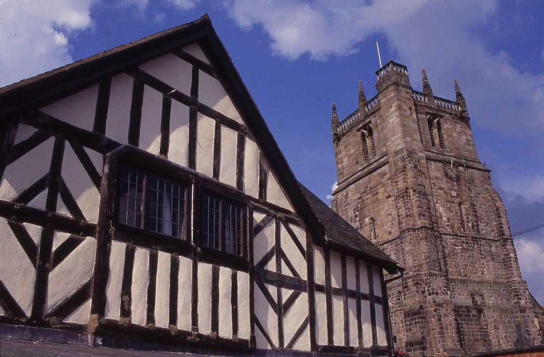 St Oswalds tower next to a timber-framed building © Shropshire Tourism