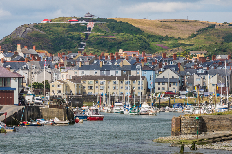 Aberystwyth Harbour with Constitution Hill behind and the town between.