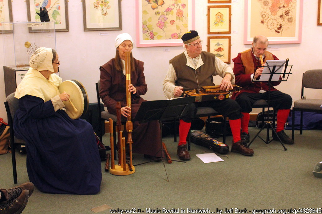 A groupp playing ancient musical instryments at the Holly Holy Day event
